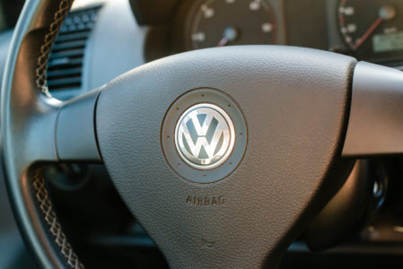 Logo of German car manufacturer Volkswagen on steering wheel